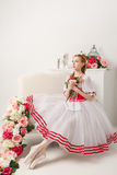 Pretty ballerina holding flowers Royalty Free Stock Photography