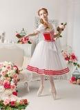 Pretty ballerina holding flowers Royalty Free Stock Photos