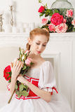 Pretty ballerina holding flowers Stock Images