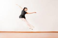 Pretty ballerina jumping in a dance studio Stock Image