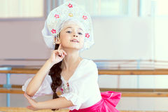 Pretty ballerina posing in Russian kokoshnik Stock Photos