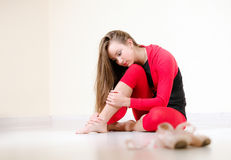 Pretty ballerina sitting on the floor Royalty Free Stock Photos