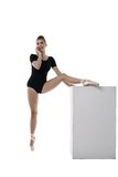 Pretty ballerina talking on phone during workout Royalty Free Stock Image