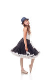 Pretty ballet dancer posing in dress and hat Royalty Free Stock Photos