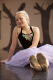 Pretty Ballet Student on Floor Royalty Free Stock Photo