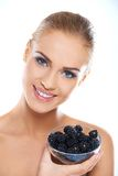 Pretty Bare Woman Holding a Bowl of Black Berries Stock Image