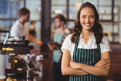 Pretty barista with arms crossed. Portrait of a barista with arms crossed at the coffee shop Stock Image
