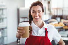 Pretty barista giving take-away cup Stock Images