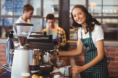 Pretty barista making a cup of coffee Royalty Free Stock Photo