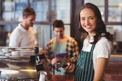 Pretty barista making a cup of coffee. Portrait of a barista making a cup of coffee at the coffee shop Stock Photography