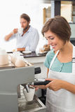 Pretty barista making cup of coffee Royalty Free Stock Photos