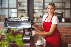A pretty barista preparing coffee Stock Photos