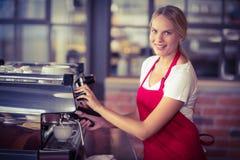 A pretty barista preparing coffee Stock Image