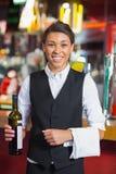 Pretty barmaid smiling at camera Royalty Free Stock Photo