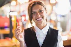 Pretty barmaid smiling at camera Royalty Free Stock Images