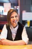 Pretty barmaid smiling at camera Stock Photography