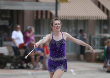 Pretty Baton Twirler in parade in small town America Royalty Free Stock Images