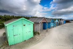 Beach Huts in Sussex. Pretty beach huts at West Wittering on the West Sussex coast Stock Photos