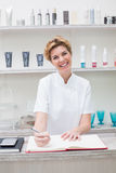 Pretty beautician smiling at camera Stock Image