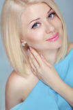 Pretty Beautiful blonde woman with short hair styling. Eyes make Stock Images