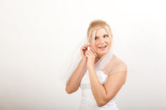 Pretty beautiful bride putting on an earring Royalty Free Stock Photography
