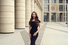 Pretty beautiful business woman in elegant black dress Royalty Free Stock Photo