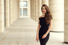 Pretty beautiful business woman in elegant black dress Stock Photography