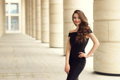 Pretty beautiful business woman in elegant black dress Stock Photo