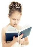 Pretty beautiful girl with a prayer book. Pretty beautiful girl with a prayer book and a rosary on a white background Stock Photography