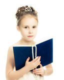 Pretty beautiful girl with a prayer book. Pretty beautiful girl with a prayer book and a rosary on a white background Royalty Free Stock Photography