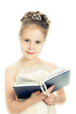 Pretty beautiful girl with a prayer book. Pretty beautiful girl with a prayer book and a rosary on a white background Royalty Free Stock Photo