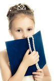 Pretty beautiful girl with a prayer book. Pretty beautiful girl with a prayer book and a rosary on a white background Stock Photo