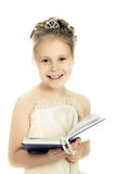 Pretty beautiful girl with a prayer book. Pretty beautiful girl with a prayer book and a rosary on a white background Stock Image