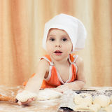 Pretty beautiful girl at the table making pies. royalty free stock photos
