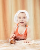 Pretty beautiful girl at the table making pies. royalty free stock images