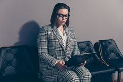 Pretty beautiful intelligent serious with trendy stylish hairdo holding checking she her lady in checkered plaid classic royalty free stock images