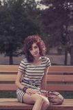 Pretty beautiful red curly hair woman at the park Stock Photos