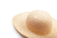 Pretty beautiful straw hat  on white background beach hat from a side view isolated - Image. Pretty beautiful straw hat  on white background beach hat from a royalty free stock photo