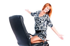 Pretty beautiful young girl on armchair Royalty Free Stock Image
