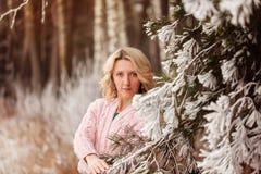 Pretty young woman in winter park. Pretty beautiful young woman in winter park Royalty Free Stock Photo