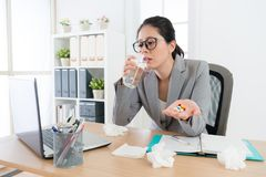Pretty beauty company worker woman drinking water Royalty Free Stock Photo