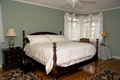 Pretty Bedroom. Light and airy bedroom with antique furnishings royalty free stock photo