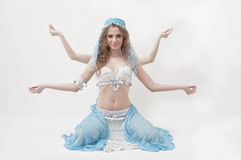 Pretty belly dancer posing on white background Stock Photos