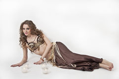 Pretty belly dancer posing on white background Royalty Free Stock Photography