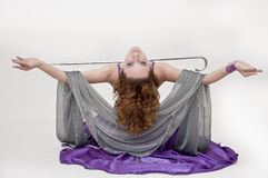 Pretty belly dancer posing on white background Royalty Free Stock Photos