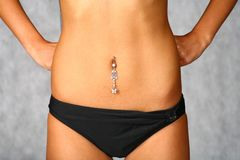 Pretty belly and piercing Royalty Free Stock Images