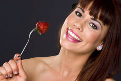 Pretty Raw Fruit Berry on Fork Female Royalty Free Stock Photo