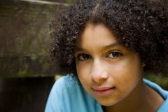 Pretty Biracial Girl #3. Interesting image of a pretty biracial girl with large brown eyes stock photography