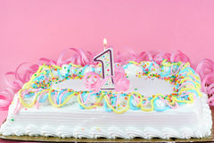 Pretty birthday cake with lit candle. Royalty Free Stock Photos