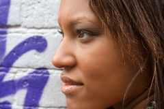 Pretty black girl. Standing next to the wall covered with graffiti Stock Photography